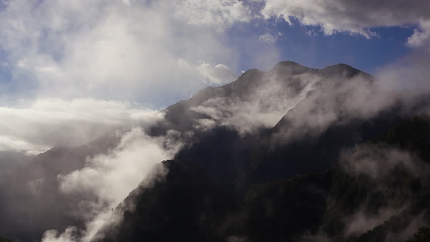 September, 2013 - Lima, Peru: WS T/L Mountains in clouds / Lima, Peru - HD stock footage clip