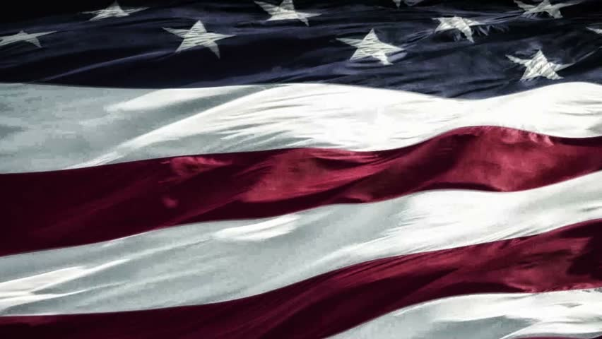Slow motion of american flag blowing in wind - HD stock footage clip