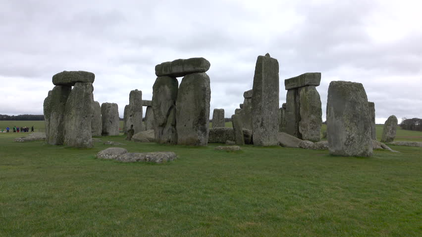 AMESBURY, ENGLAND - MAR 2016: Tourists Stonehenge prehistoric monument Amesbury England. Prehistoric monument dating to 3000 BC. UNESCO's World Heritage Site. Tourism attraction myths and mysteries.