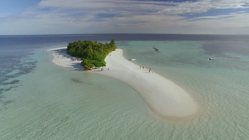 Flight over of a small tropical island in Maldives island, 2015.