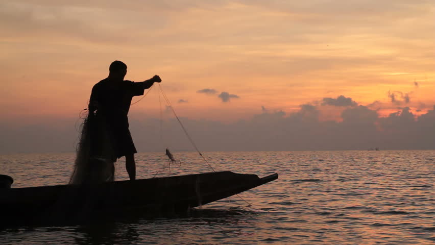 Silhouette of Fishermen fishing  in the lake at the sunrise time. - HD stock footage clip