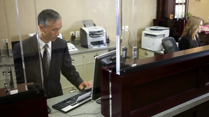 Two colleagues working in bank - HD stock footage clip