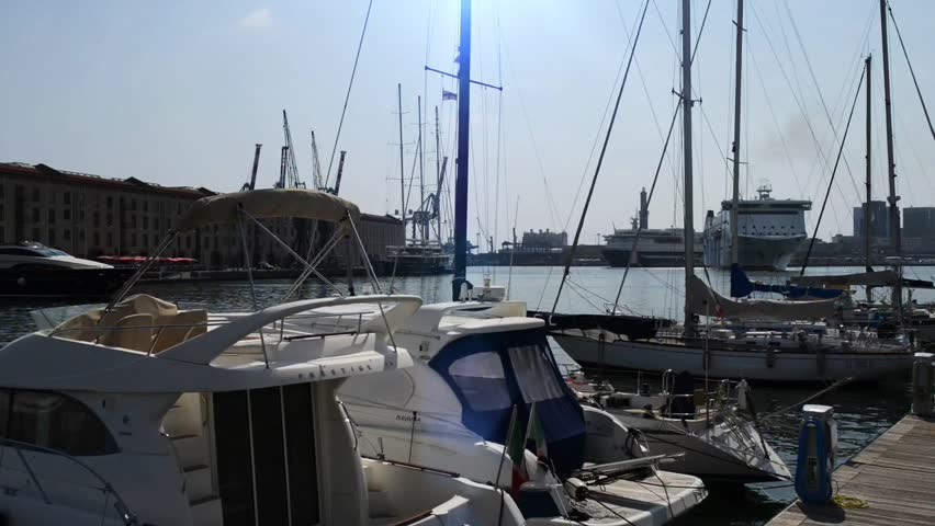 Port of Genoa is a major Italian seaport on the Mediterranean Sea. With a trade volume of 51.6 million tonnes, it is busiest port of Italy by cargo tonnage. Port is also used as a dismantling station - HD stock video clip