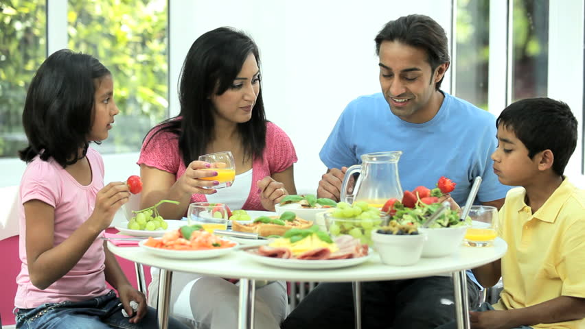 A family gathering at the dinner table stock footage video for Japanese eating table