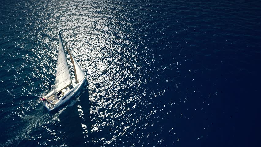 Yacht sailing on opened sea. Sailing boat. Yacht from drone. Yachting video. Yacht from above. Sailboat from drone. Sailing video. Yachting at windy day. Yacht. Sailboat. | Shutterstock HD Video #16596535