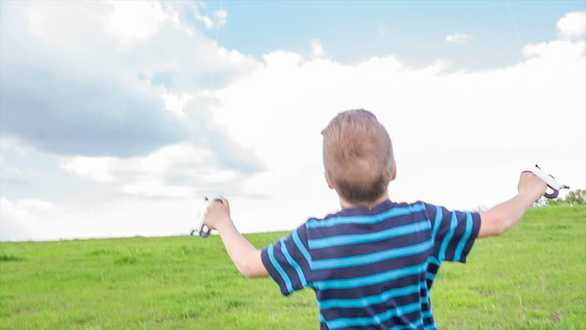 Boy with colorful kite on the green hill | Shutterstock HD Video #16607776