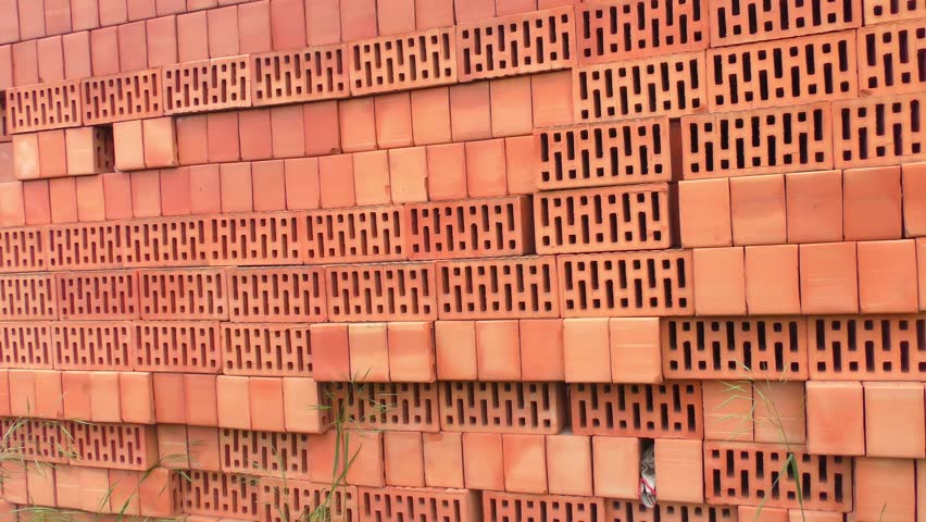 Red brick stack near wall - 4K stock footage clip