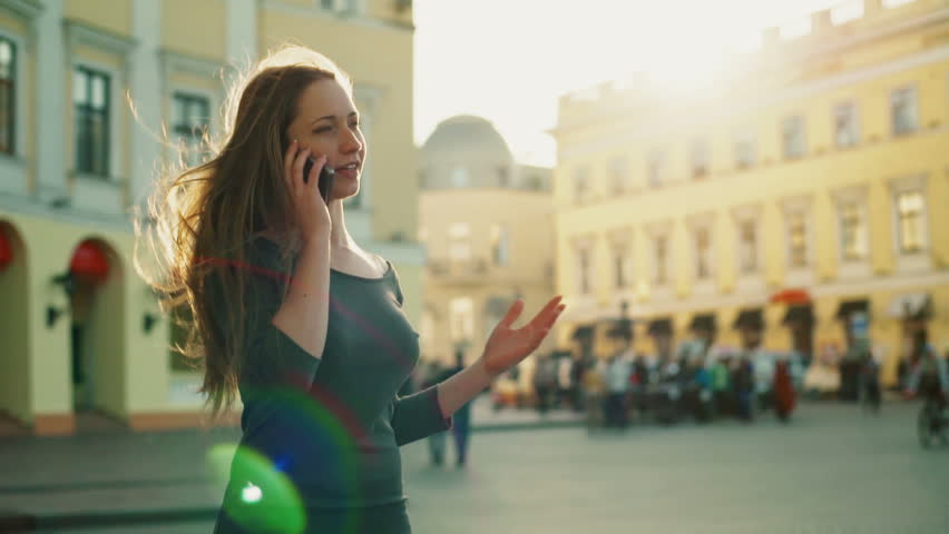 Happy female talks on the phone in the city centre slow motion | Shutterstock HD Video #16692025