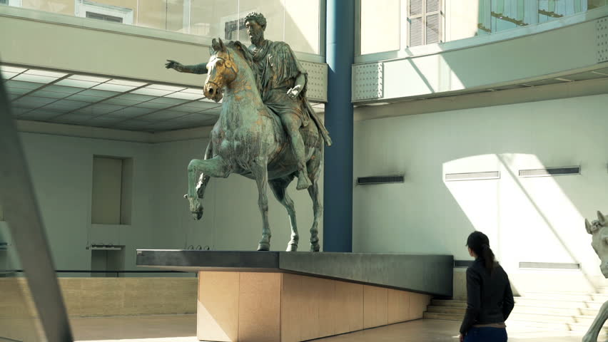 17.03 2016 Rome Italy: Tourist looking at roman equestrian statue of Marcus Aurelius at Capitoline Museums  - HD stock footage clip