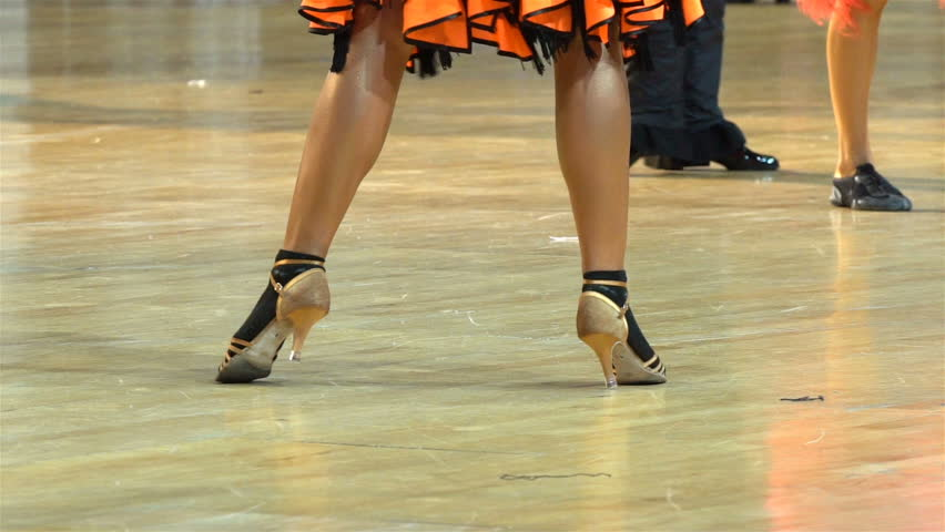 Close-up of legs of dancing couples in ballroom. Slow motion. - HD stock video clip