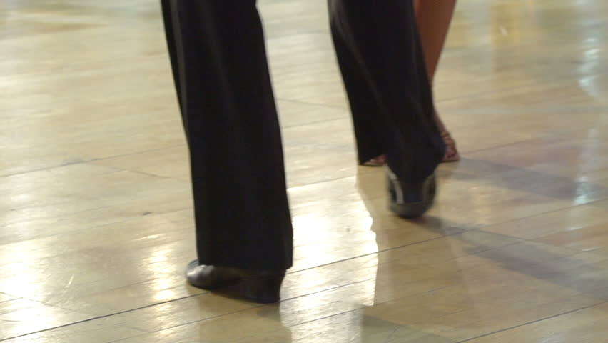 Close-up of legs of dancing couples in ballroom. Slow motion. - HD stock footage clip