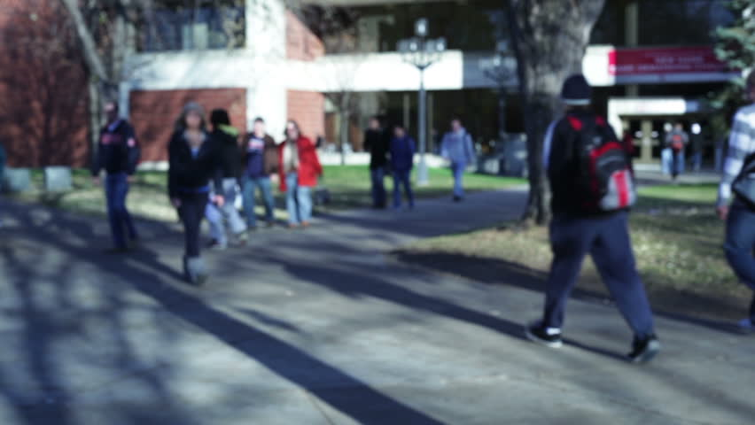 College students walking on a university campus.  | Shutterstock HD Video #1682626