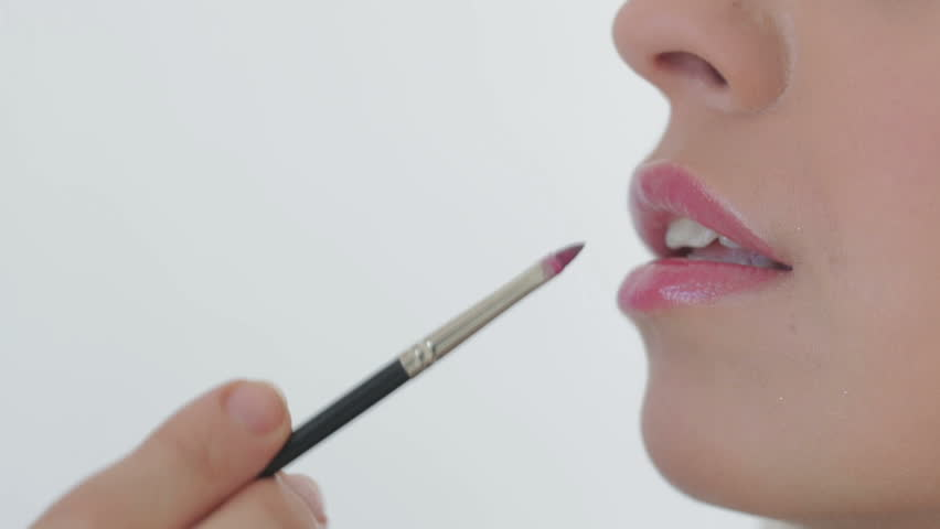 Artist doing professional make up of woman - HD stock footage clip