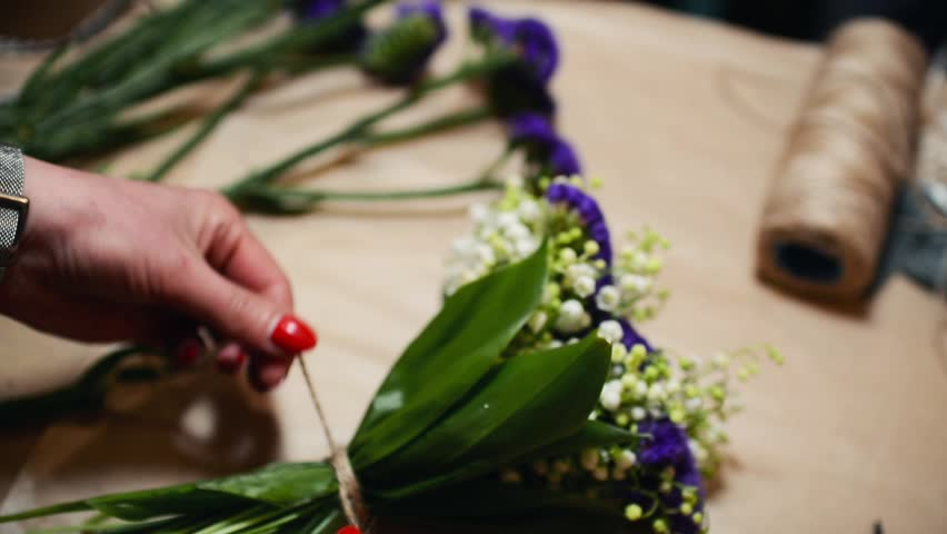 Flower Shop, Florist Arranging Modern Bouquet, Tying Ribbons to Make a Bow | Shutterstock HD Video #16874770