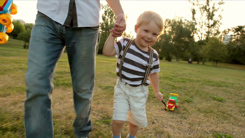 father and little boy running with toy car (slow motion) - HD stock footage clip