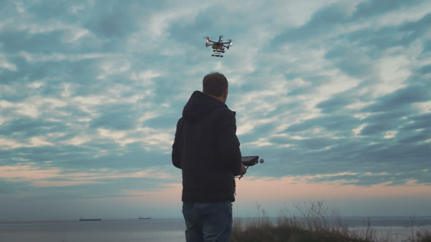Custom drone hexacopter flies in the sky | Shutterstock HD Video #16895515