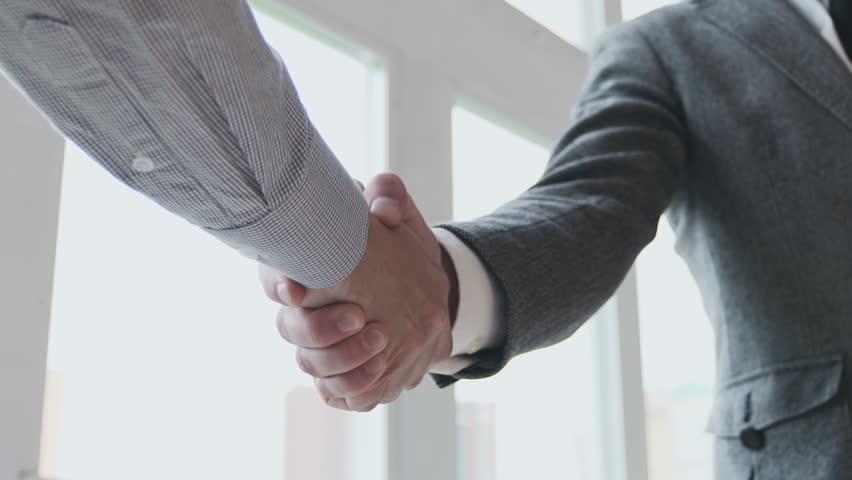 Business partners handshaking. Slow motion 100 fps   Shutterstock HD Video #16923532