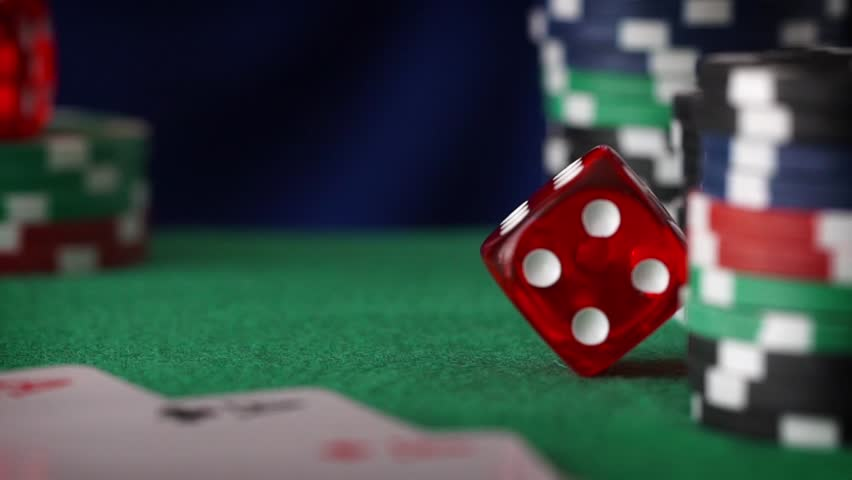 Red dice in sequence rolls, casino chips, cards on green felt | Shutterstock HD Video #16940362