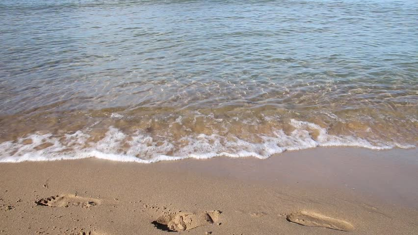 waves clear footprints - HD stock footage clip