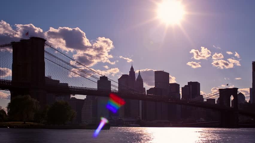 New York City sunset with Brooklyn Bridge - HD stock footage clip