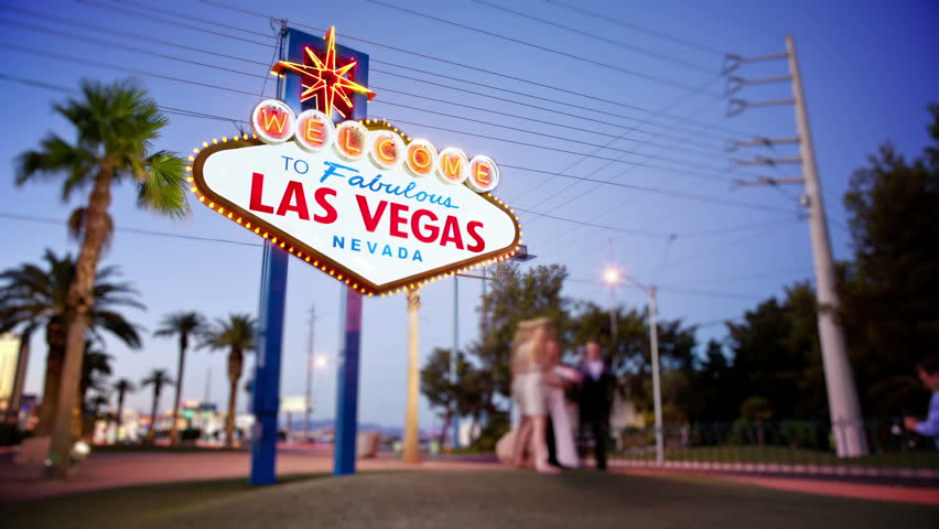 Timelapse of People taking photos in front of Welcome to Las Vegas sign | Shutterstock HD Video #1698970