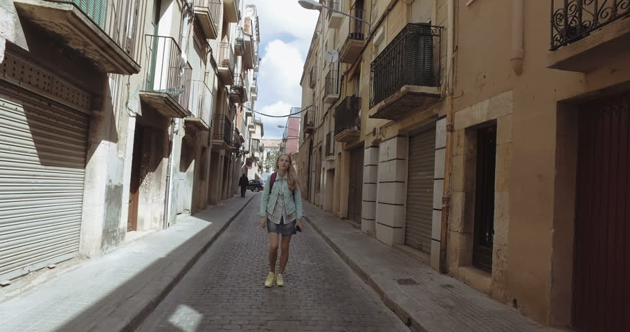 Young tourist woman walk alone at the gothic streets - 4K stock footage clip