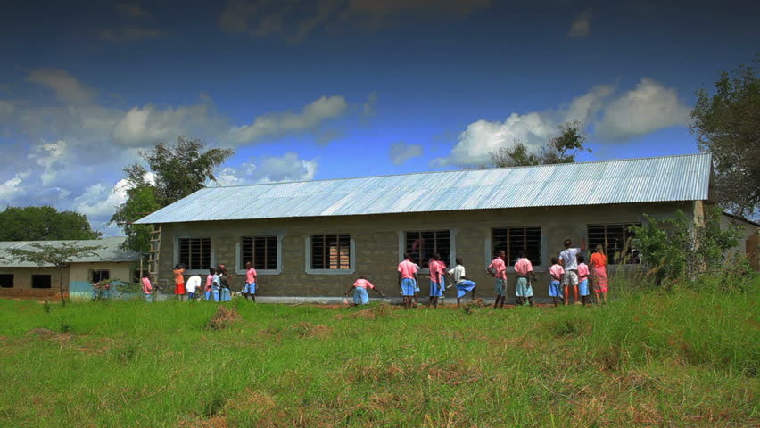 Painting the exterior of a school in a village in Kenya two hours north of the Africa city Mombassa.