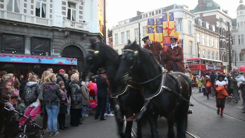 THE HAGUE, HOLLAND - NOVEMBER 12 - Horse-drawn cab with gifts rides in The Santa Claus (Sinterklaas) parade on November 12, 2011 in The Hague, Holland. Sinterklaas is a traditional festival in Holland - HD stock footage clip