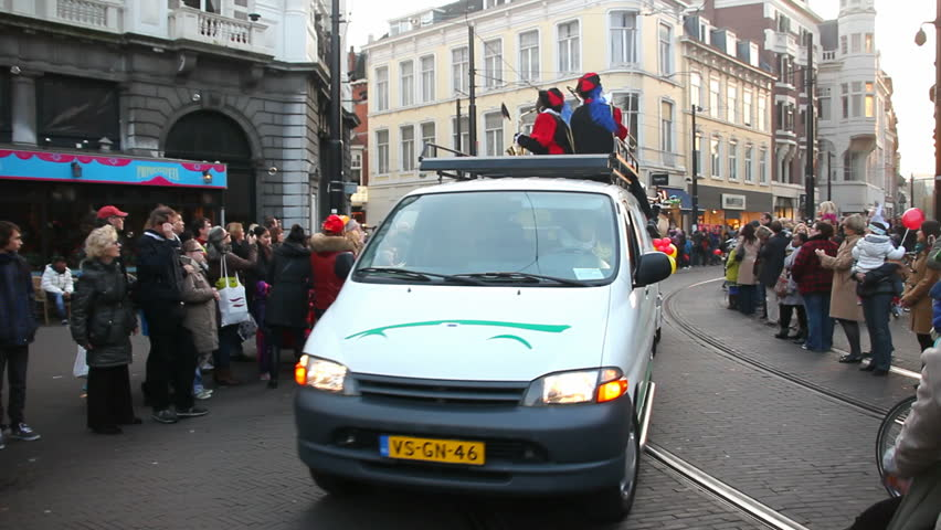 THE HAGUE, HOLLAND - NOVEMBER 12 - The Santa Claus (Sinterklaas) parade with a brass band arrives on November 12, 2011 in The Hague, Holland. Sinterklaas is a traditional festival in Holland - HD stock video clip