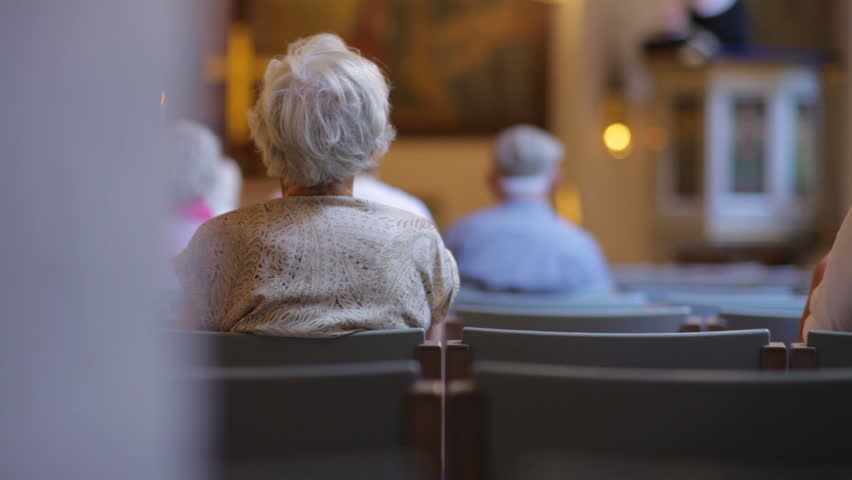 View from behind of people sitting in church in Copenhagen, Denmark - HD stock video clip