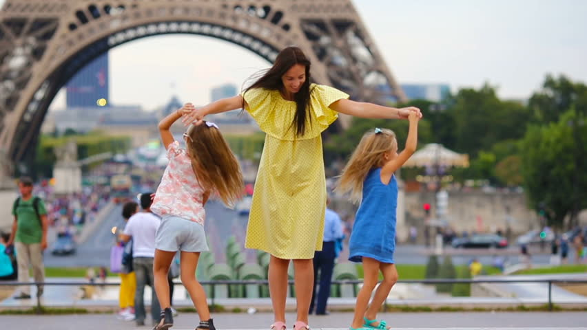 Happy family in Paris near Eiffel tower. French summer holidays, travel and people concept. | Shutterstock HD Video #17026528