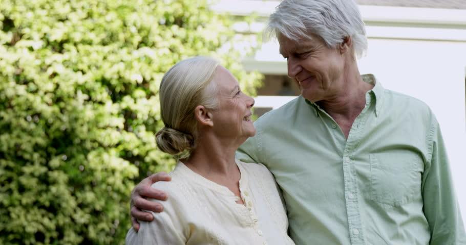 Lovely elder couple in the garden and enjoying good weather - 4K stock video clip