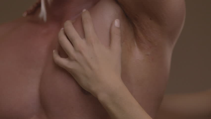 Hands of young woman touching athletic torso with abs of man. Ungraded - HD stock footage clip