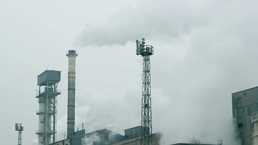 Heavy industrial pollution. Factory chimneys emitting smoke to the air. HD 1080i.  - HD stock video clip