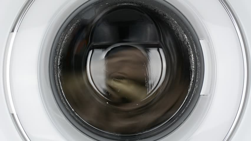 Placing dirty clothes in a washing machine./ The fabric is wearing./ Put it in the Blender tank of a washing machine. - HD stock video clip