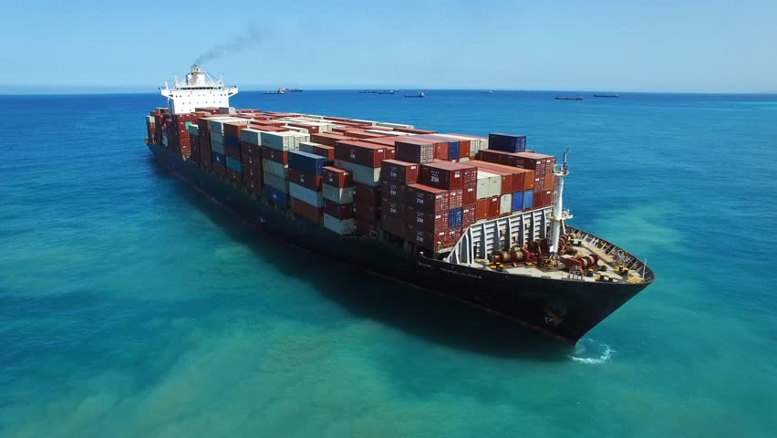 Haifa, Israel, June 7, 2016: Aerial footage of Zim Shekou Container cargo ship at sea, loaded with containers, heading to her next port.   Shutterstock HD Video #17155201