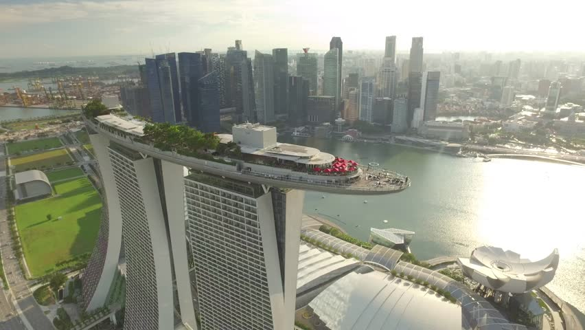 SINGAPORE, MAY 2016: Travelling aerial shot of Marina Bay Sands with Singapore City Skyline as background - May 2016 (Singapore) | Shutterstock HD Video #17167999