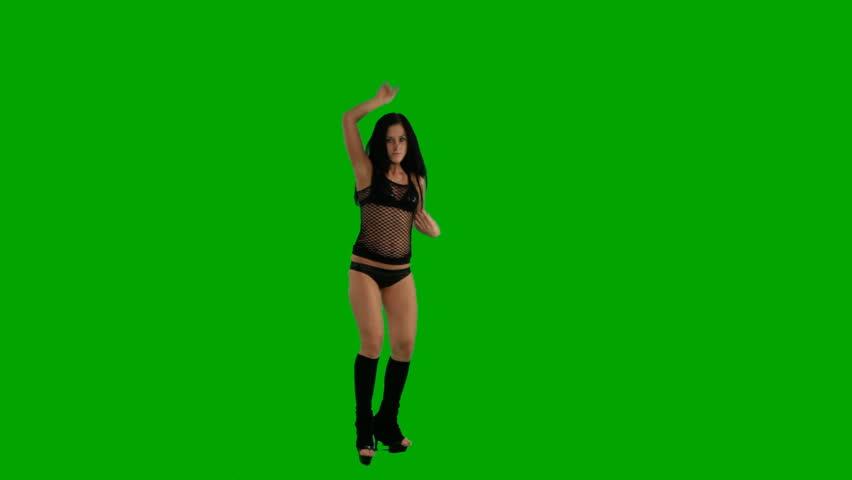 Beautiful young girl dancing against green screen  - HD stock footage clip