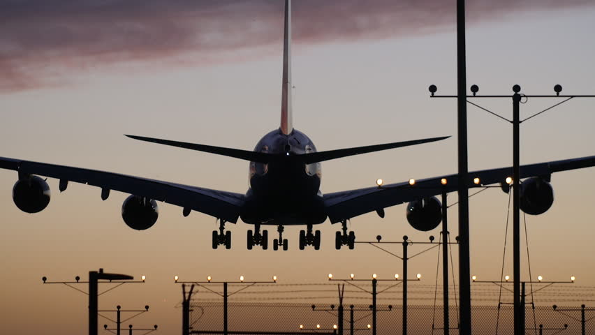 A Dramatic Shot of a 747 Landing at Sunset in Slow Motion. | Shutterstock HD Video #17191912