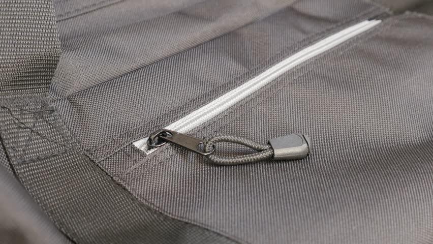 Zipper of travel bag and fabric details slow tilt 4K 2160p 30fps UltraHD footage - Modern travel bag with lot of details 4K 3840X2160 UHD tilting video