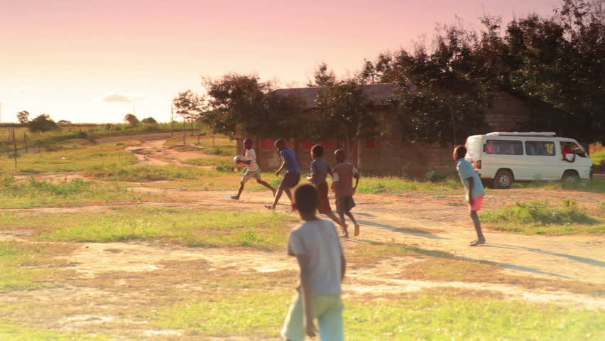 KENYA, AFRICA - CIRCA 2011:  Children playing soccer on the fields in Kenya, Africa. - HD stock video clip