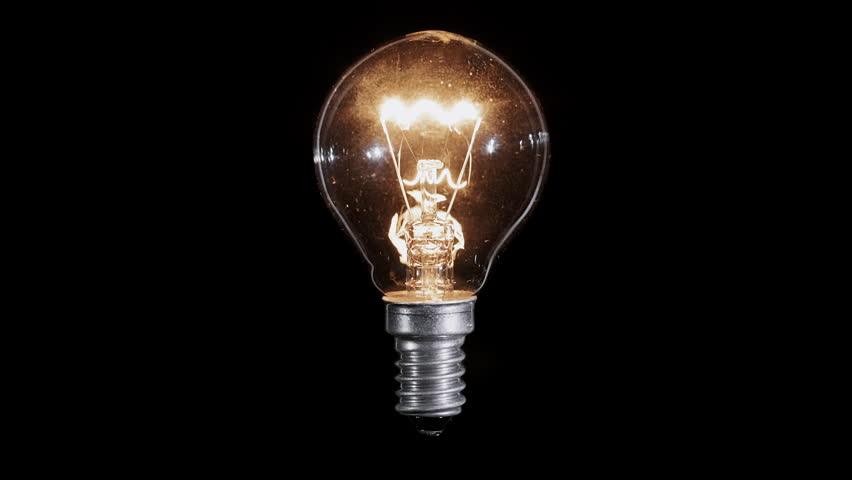 Medium shot of tungsten light bulb being turned off to black stock footage video 41847 Tungsten light bulbs