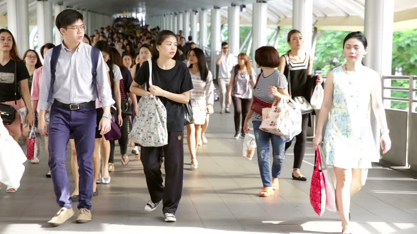 BANGKOK, THAILAND, CIRCA JUNE 2016, morning commuters walking towards view on sky train pier with one young Muslim woman in head scarf hijab using smart phone | Shutterstock HD Video #17265235