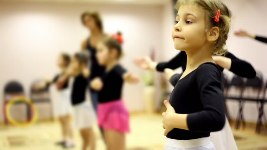 Girls learn how to dance with ballet teacher in recreation center - HD stock video clip