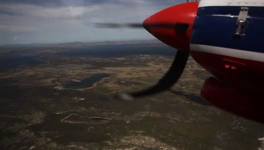 Falkland island, aerial view. Flight above Falkland Island. Landscape of Falkland Island. River in the landscape. Landscape from aeroplane. Falkland Island from airplane. Aircraft view of Falkland.