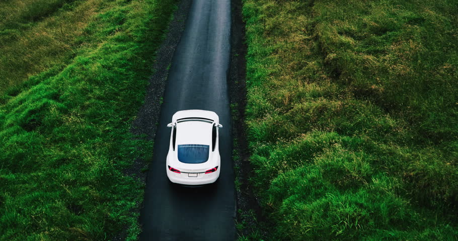 Aerial view electric car driving on country road, luxury car driving through mist at dusk with headlights | Shutterstock HD Video #17354407