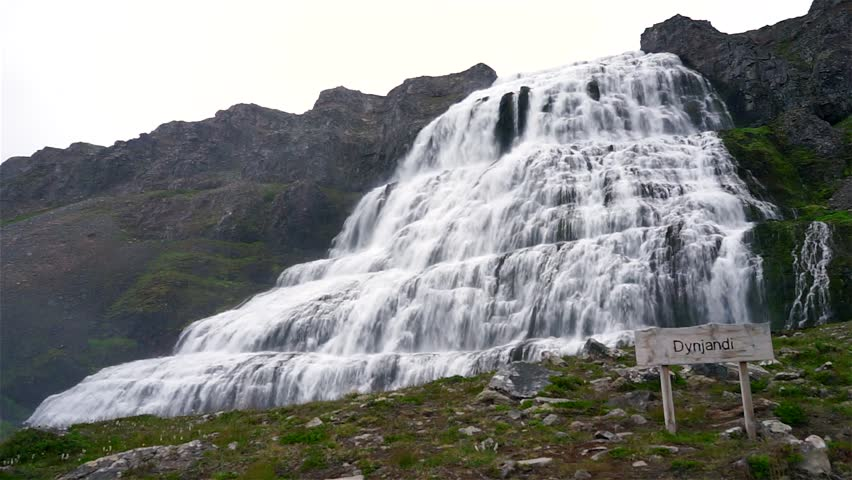 Scenic view of Dynjandi Waterfall, Westfjord, Iceland. Footage of a huge Dynjandi waterfall running in cascades from a mountain. - HD stock footage clip