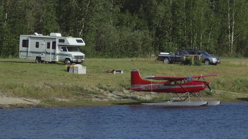 Fairbanks, Alaska, USA - JULY 2015. Camper Near The Float Planes Parking At  Fairbanks International Airport. - HD stock footage clip