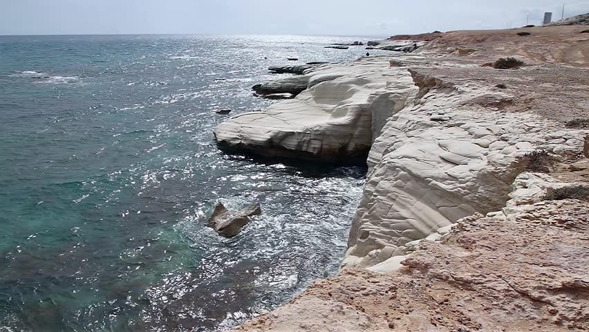 White cliffs and blue sea. Sun glare on the sea. Mediterranean Sea. Cyprus coast. Beautiful sea landscape of the island of Cyprus with a rocky shore.   Shutterstock HD Video #17419036