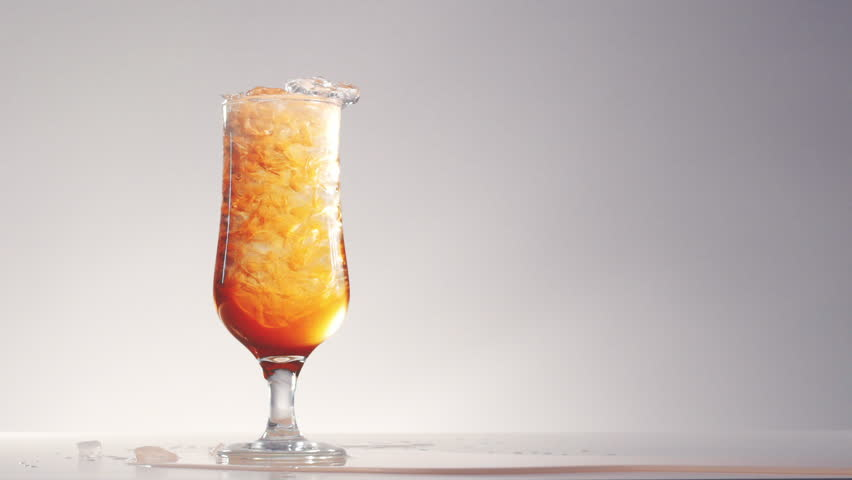 Slow motion, hand decorates with lemon aperol drink in high ball glass full with crushed ice isolated on white on left side and pours out   Shutterstock HD Video #17450536